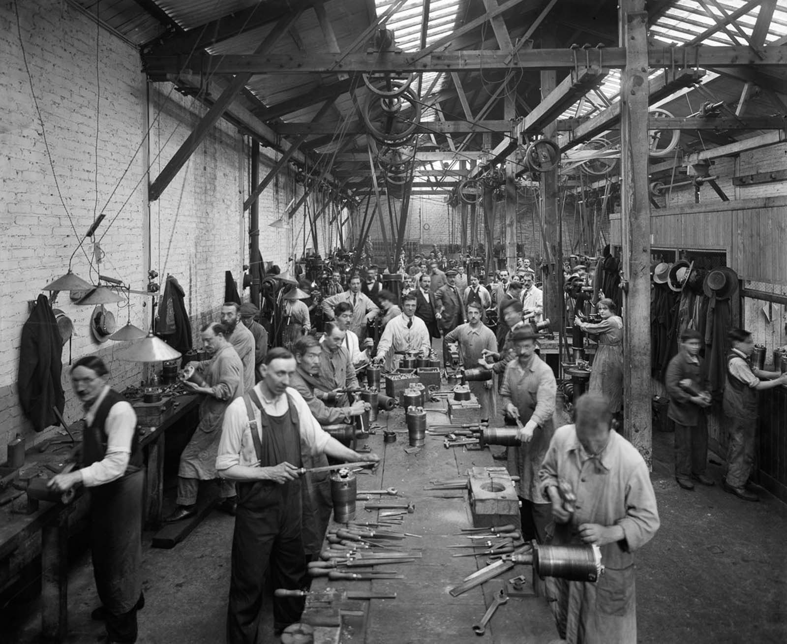 Belgian refugees manufacture artillery shells at the Belgian Munition Works in London. 1918.