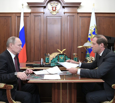 Vladimir Putin with Denis Manturov, Minister of Industry and Trade, Russian Federation.