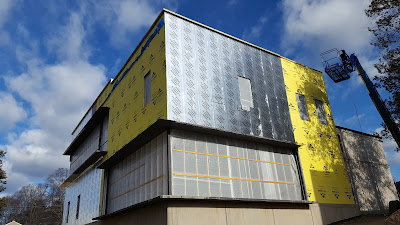 construction on the Library is making progress, additional insulation is being added to the exterior