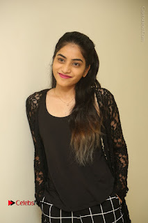 Actress Punarnavi Bhupalam Stills in Black Dress at Pittagoda Press Meet  0007.JPG