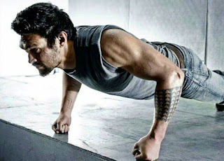 A man doing knuckle push ups