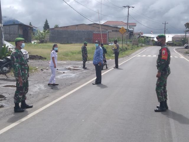 Personel Jajaran Kodim 0207/Simalungun Laksanakan Ops PPKM Level lV Diwilayah Kabupaten Simalungun