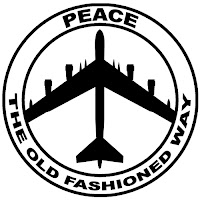 Peace symbol shape, made with a vertically oriented B52 bomber, with the words Peace The Old-Fashioned Way