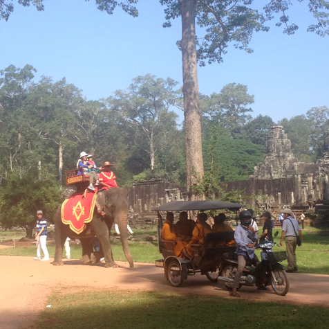 elephant, tuk tuk, monks, and khmer ruins in Siem Reap, Cambodia
