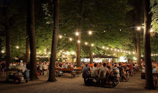 A traditional beer garden in Munich at night by Martin Falbisoner