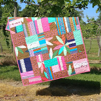http://www.sliceofpiquilts.com/2019/06/boho-chic-baby-quilt.html