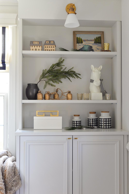 traditional christmas decor, christmas bookshelves, bookshelf styling, living room at christmas