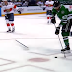 Mike Hoffman tosses stick at Alex Radulov trying to stop empty net goal
