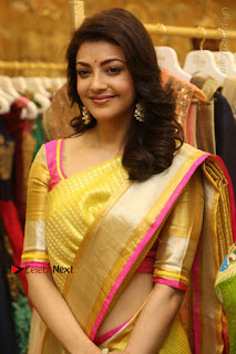 Actress Kajal Agarwal Stills in Golden Silk Saree at Trisha Sesigner Store Launch  0016.jpg