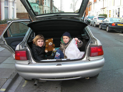 children in the boot of the car
