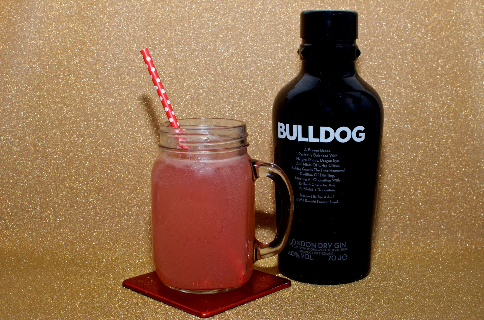 Pink cocktail and bottle of bulldog gin