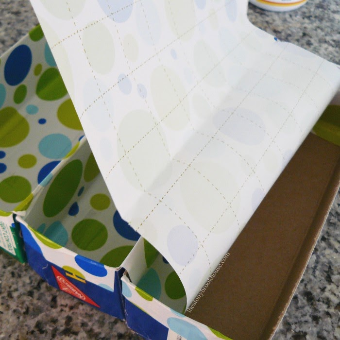 covering boxes with wrapping paper