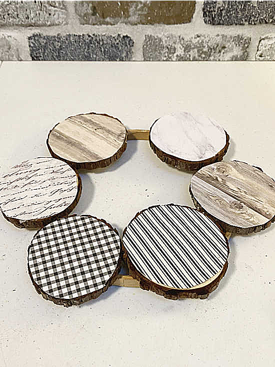 wood slices covered with scrap book paper