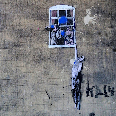 Banksy painting, featuring a man and woman looking out of a window and a naked man hanging from the sill.