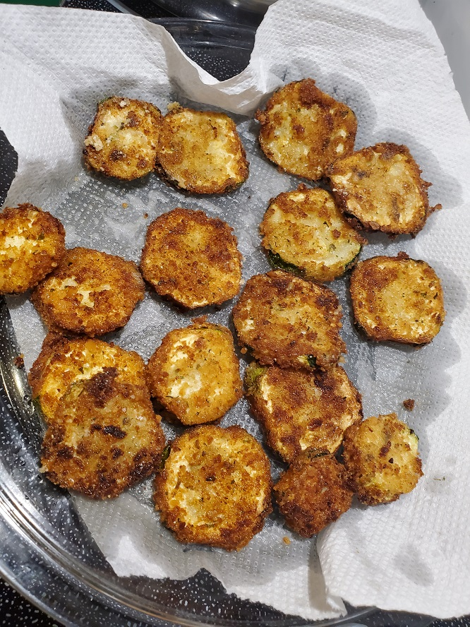 these are fried zucchini chips draining on paper towels