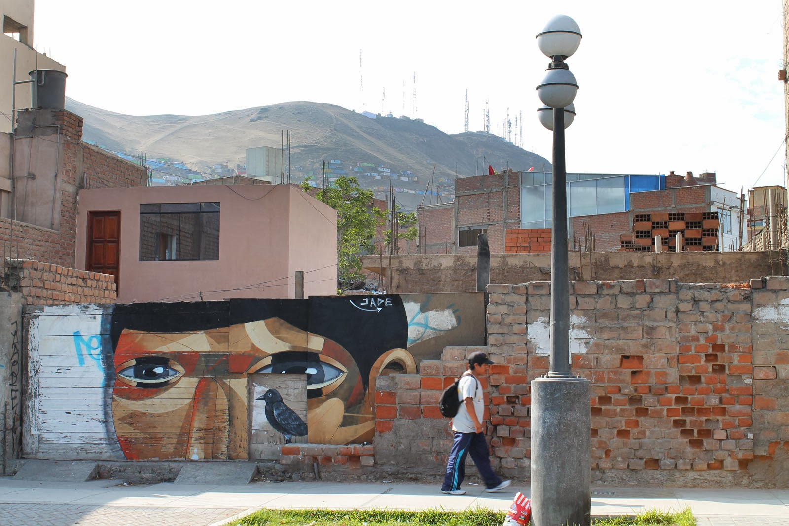 """""""The Host"""" a new street art piece by Peruvian artist JADE in the Chorillos district of Lima, Peru. 4"""