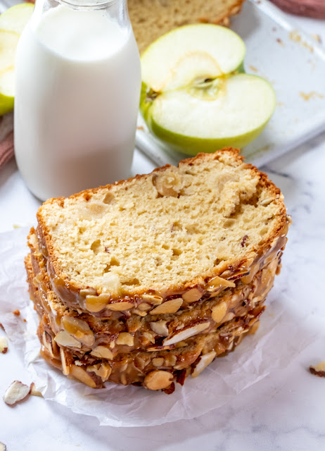 This delicious fall bread is packed with chunks of apples and topped with a delicious, buttery caramel almond mixture! Try it for breakfast, snack or dessert and enjoy every last bite!