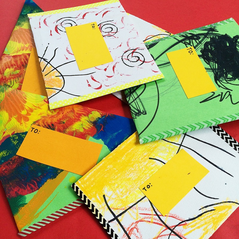 kids drawings recycled as envelopes