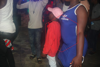 (PHOTOS) What Is This 7-Year Old Boy Doing At Kegite Night Gyration?