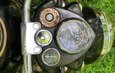 Close up for Royal Enfield motorcycle with rust on dashboard.