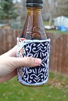 http://www.marymarthamama.com/crafty-cat/insulated-drink-cozy-tutorial/