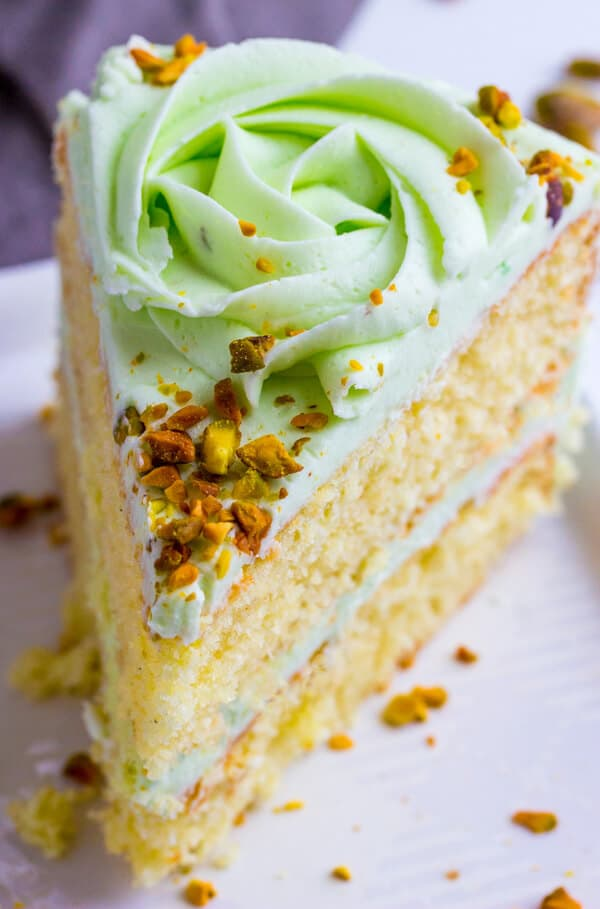 Vanilla Bean Pistachio Cake - Light, airy and full of flavor this Vanilla Bean Pistachio Cake is a fun and tasty flavor combination perfect for absolutely any occasion.