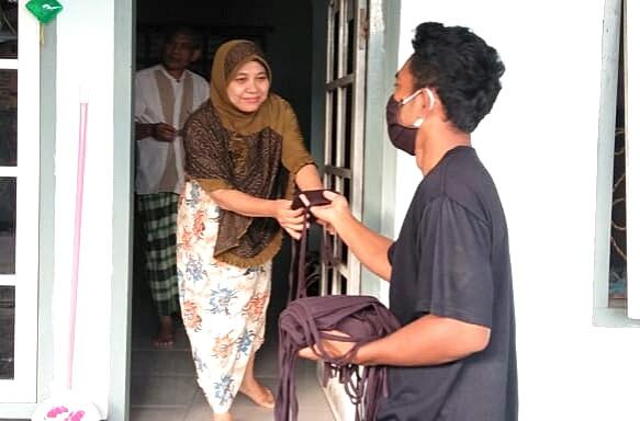 Pemerintah Desa Anjani Bagikan 9.300 Masker Gratis