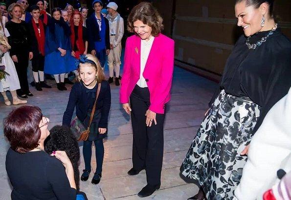 Crown Princess Victoria wore Baum Und Pferdgarten Sashenka metallic midi skirt. Princess Estelle and Queen Silvia