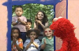 Elmo opens the door, there are kids applauding. Sesame Street Elmo's World Hands