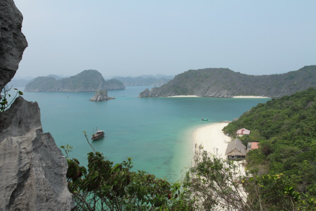 Remote white sandy beach in Halong Bay, Vietnam