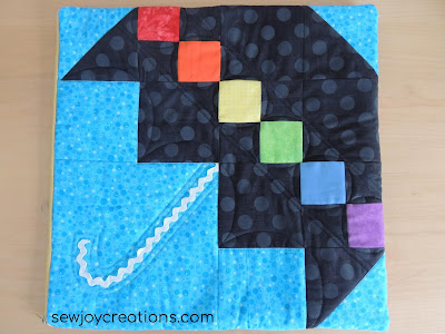 pieced umbrella block quilted cushion cover