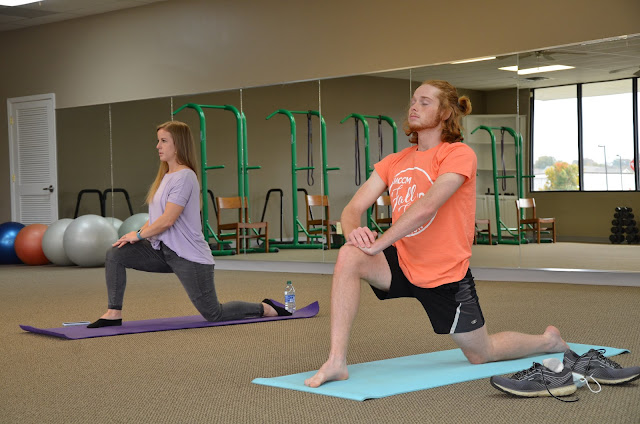 students in yoga pose