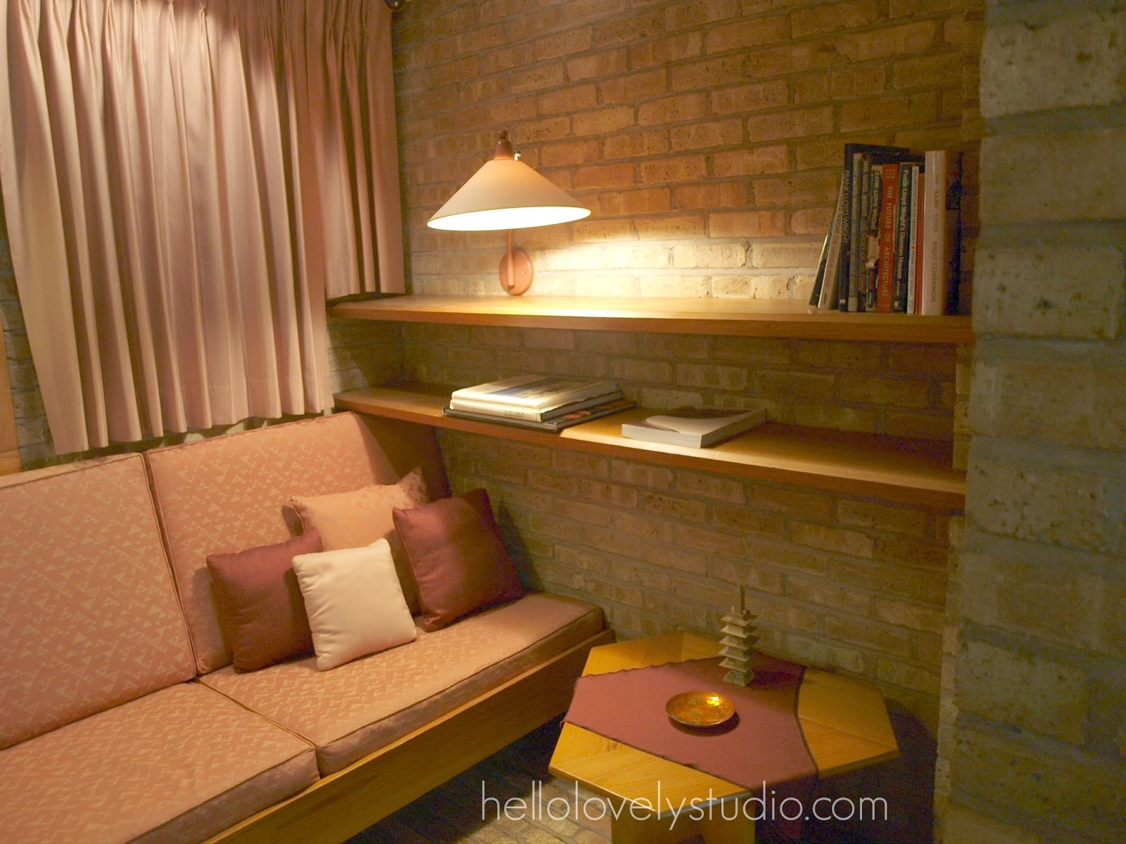 Brick wall and mauve upholstery. Frank Lloyd Wright Laurent House designed for owner Kenneth Laurent on Spring Brook Road in Rockford/ Designed to be wheelchair-accessible. #flw #franklloydwrighthouse #midcenturymodernarchitecture