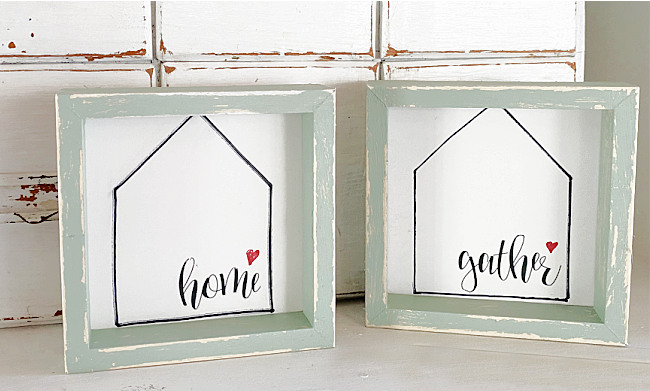 home and gather signs on a shelf