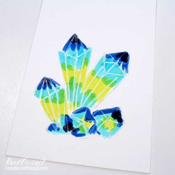 Use the Tombow Dual Brush pens to add color to the crystal cluster