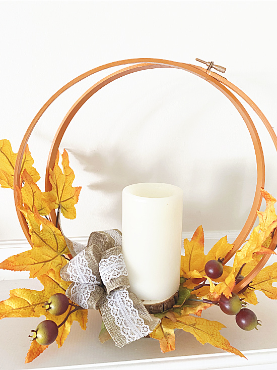 flameless candle with hoop and leaves