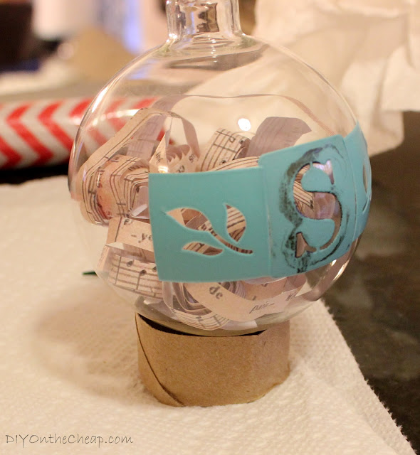 Create a monogrammed ornament with glass paint.