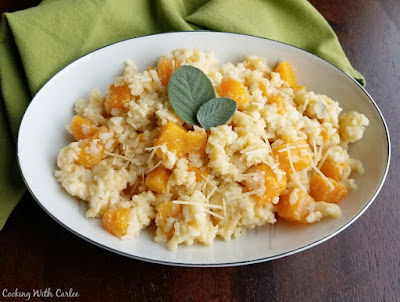 bowl of creamy risotto with cubes of butternut squash