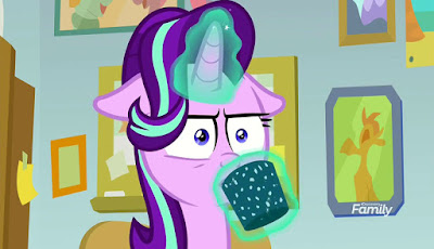 Starlight Glimmer attempting to look serious as she drinks cocoa