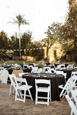 simple black reception tables with white chairs