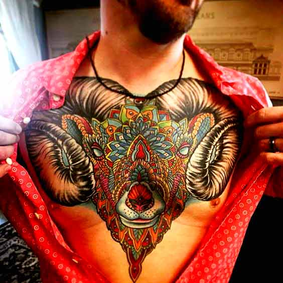 A colorful aries tattoos for men on chest