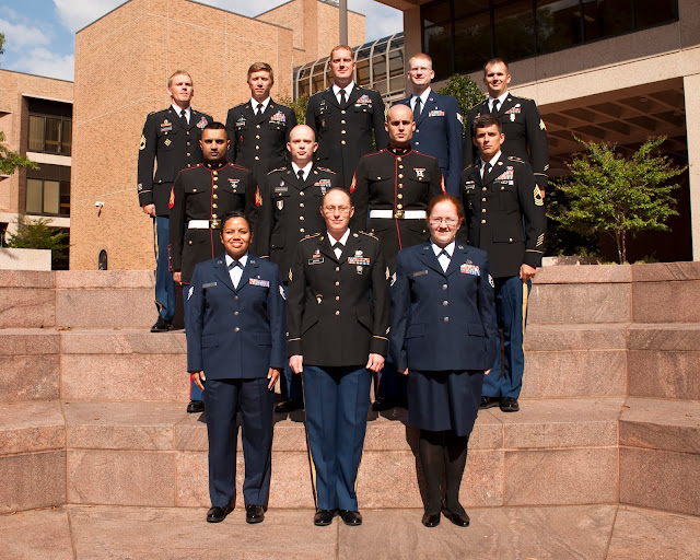 A group of uniformed EMDP2 students standing on steps.