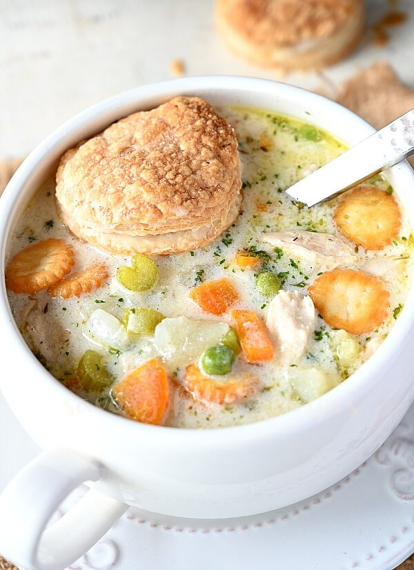 a white soup bowl with homemade chicken pot pie soup