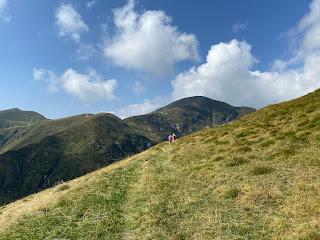 Rounding the last curve in trail 104 before reaching Rifugio Grassi. Zuc di Cam in view.