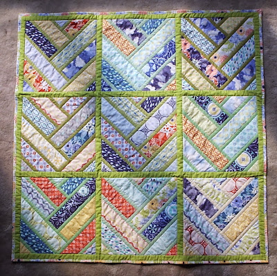 http://sewfreshquilts.blogspot.ca/2013/09/finished-broken-herringbone-baby.html