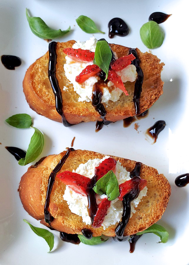 this is a sweet bruschetta appetizer with strawberries and ricotta