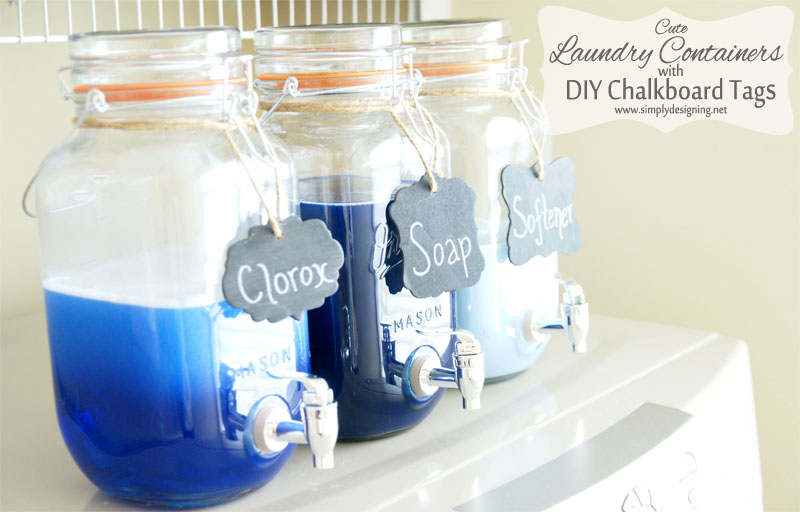 angled view of three Mason Jar Laundry Soap dispenser with DIY Chalkboard Tags on top of a washing machine
