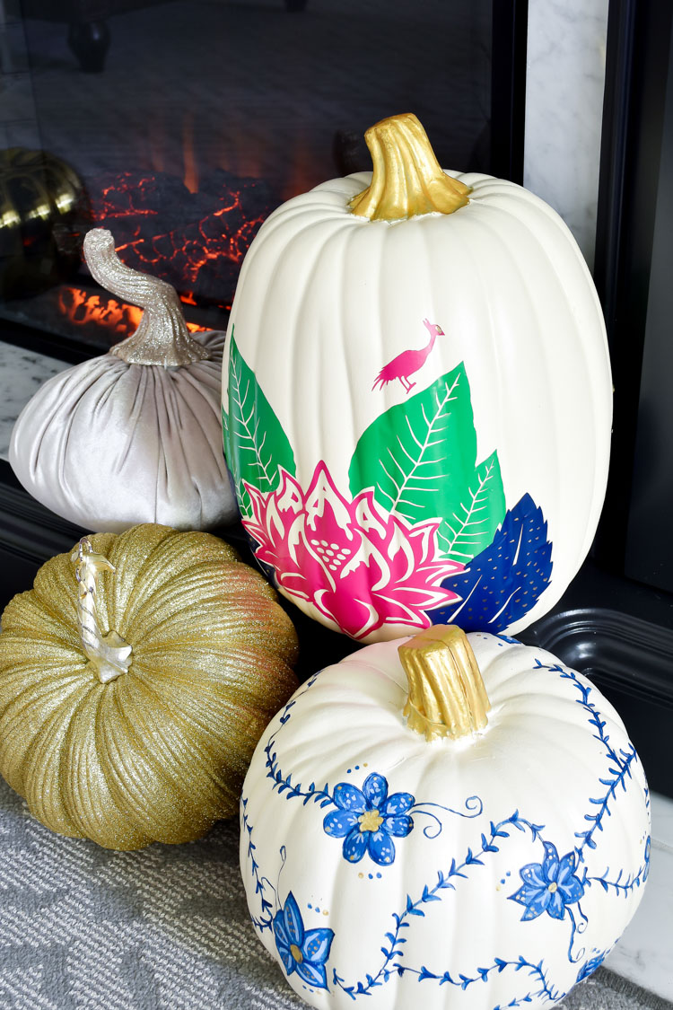 DIY tobacco leaf pumpkin craft with a blue and white ginger jar inspired painted pumpkin on a gray and marble fireplace hearth. #falldecor #pumpkins #pumpkin #pumpkindecor #pumpkincrafts