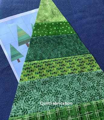 tree made of many different green fabrics for The Great Outdoors quilt by QuiltFabrication