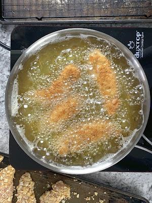 chicken tenders frying in oil